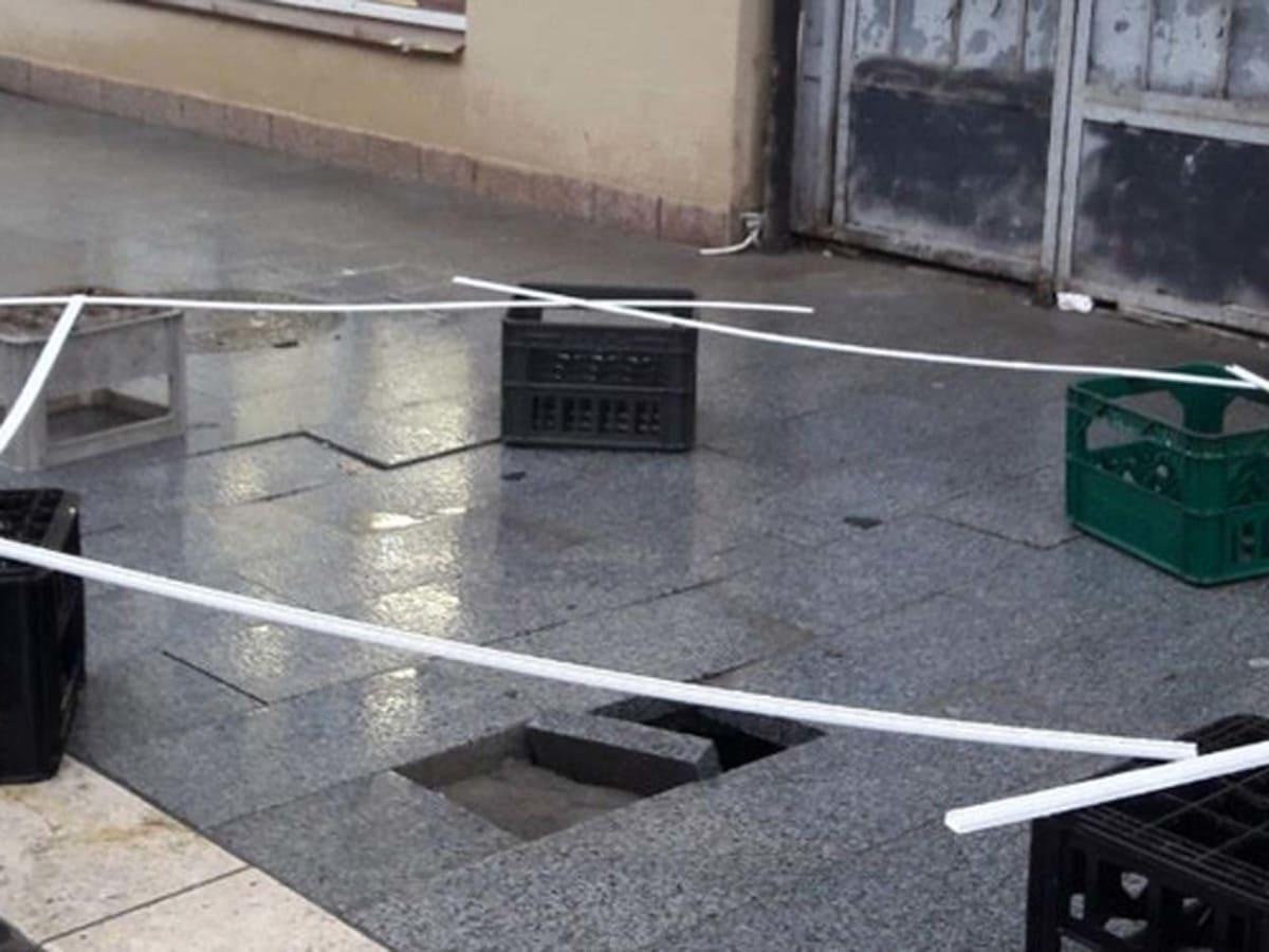 провалився тротуар на відремонтованій площі